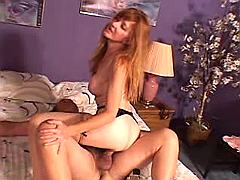 Longhaired redhead mommy jumps on...