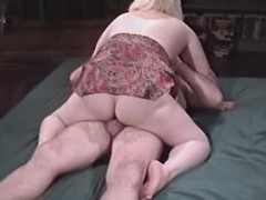 Paunchy blonde woman fucking with...