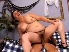 Fat mature jumps on dick